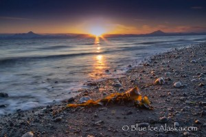 "Sunset over Cook Inlet, Alaska. ""Another beautiful sunset in Cook Inlet, Alaska. Mount Redoubt, 9,150 ft (2,700 m), is on the right and Mount Iliamna ,10,016 ft (3,053 m) is on the left. Both mountains are volcanos in the Chigmit Mountain subrange and both are in the north end of the Aleutian volcanic arc. Mt. Redoubt is an active volcano and although Mount Iliamna produces steam plumes its has not erupted for many, many years but radiocarbon dating indicates past eruptions."""
